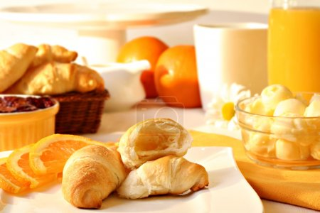 Photo for Fresh croissants with butter and jam, orange juice and coffee. - Royalty Free Image