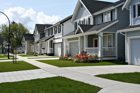 Photo for Small town residential street of new town homes. - Royalty Free Image