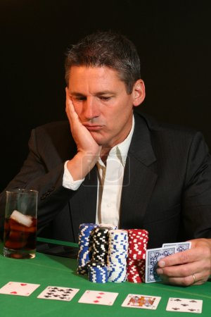 Poker player contemplating his next move
