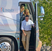 The Romneys leaving the bus