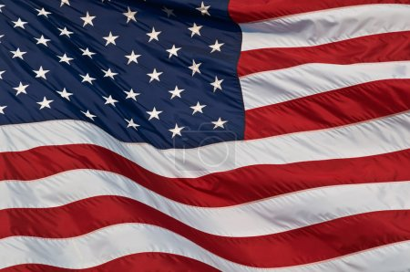 Photo for Image of the american flag flying in the wind. - Royalty Free Image