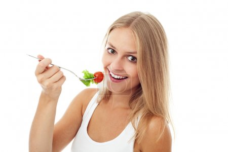 Pretty Girl eating salad. Isolated