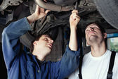 Two Car Mechanic repairing car