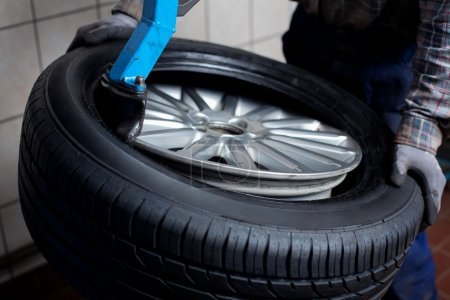 Photo for Mechanic changing car tire closeup - Royalty Free Image