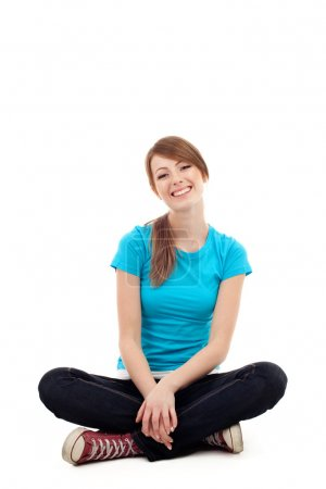 Pretty female student sitting Isolated