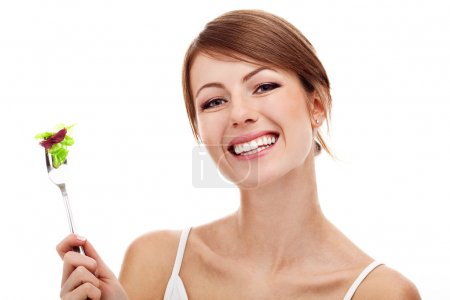 Woman with salad on fork, isolated