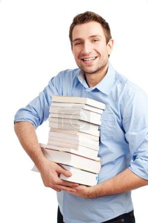 Photo pour Heureux étudiant debout avec des livres. Isolé sur blanc . - image libre de droit