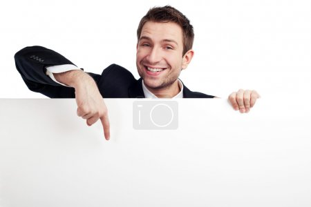 Businessman pointing at billboard