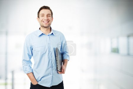 Photo for Handsome businessman with laptop standing - Royalty Free Image