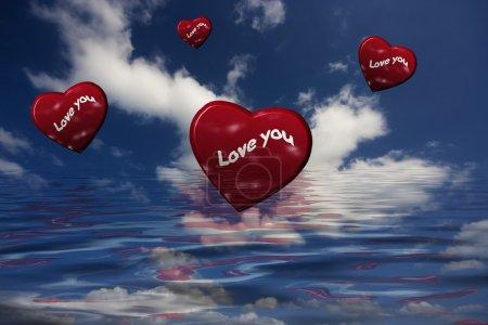 Photo pour Je t'aime tellement. Des coeurs rouges volent dans le ciel - image libre de droit