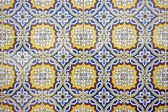 Tile pattern in blue, yellow and white in Portugal
