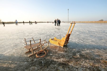 Sledges in wintertime on a frozen lake in the Neth...