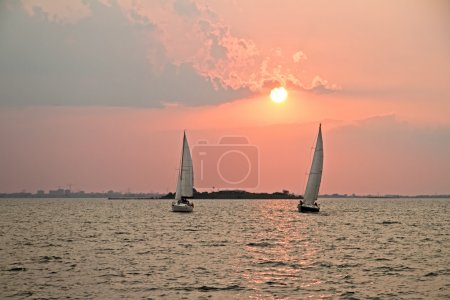 Photo for Sailing on the IJsselmeer at Pampus in the Netherlands with sunset - Royalty Free Image