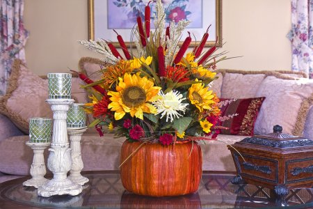 Fall and autumn floral arrangement on home's coffee table