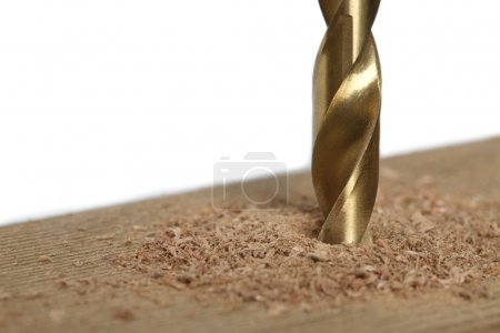 Cropped image of drilling a piece of wood