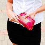 Woman opens an empty wallet