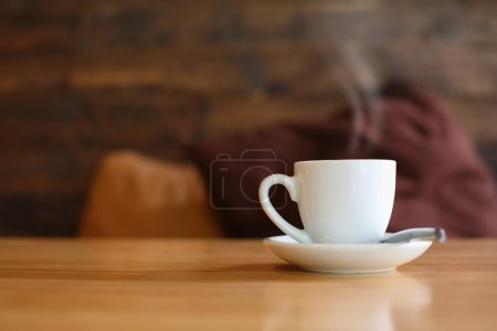 Photo for White hot coffee cup on cafe table - Royalty Free Image