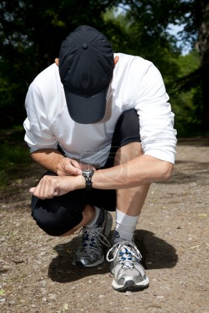 Photo for A runner setting his stopwatch - Royalty Free Image