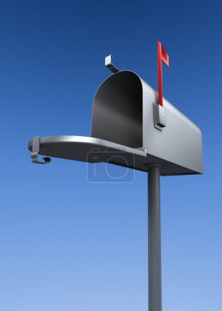 Open metal mail box with raised flag in front of a...