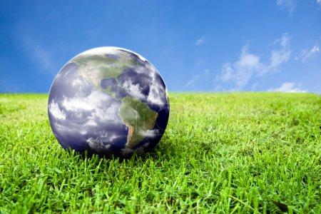 Earth in beautiful green grass