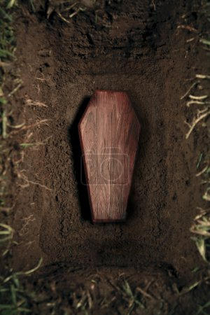 Photo of wooden coffin at a graveyard...