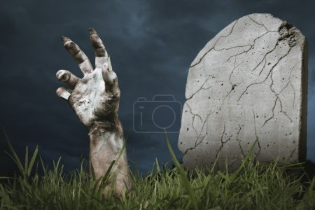Zombie hand coming out of his grave...