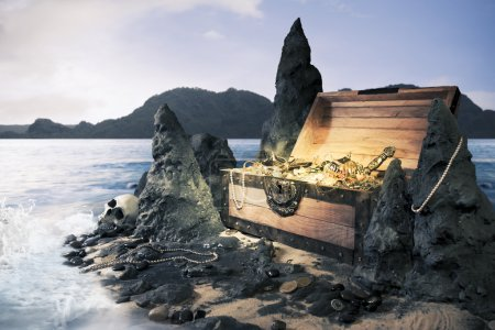 Photo of open treasure chest with shinny gold...