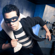 Thief running out of a bank vault, low-key photo...