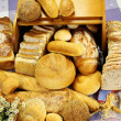 Selection of different types of rolls, loaves and ...