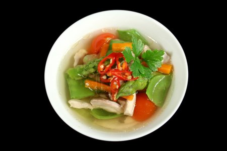 Photo for Piping hot low carb chicken and vegetable soup raedy to serve. - Royalty Free Image