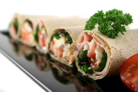 Photo for Mixed platter of delicious ham and chicken salad wraps. - Royalty Free Image