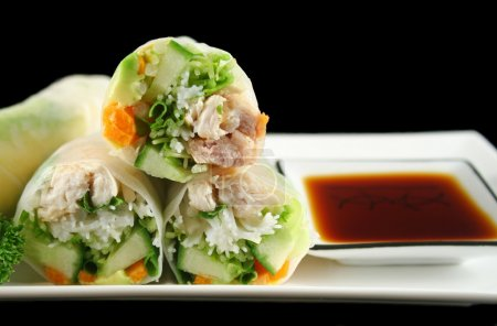 Photo for Delicious and healthy Vietnamese rice paper rolls with chicken and vegetables. - Royalty Free Image