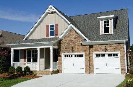 Photo for Suburban house exterior with two car garage - Royalty Free Image