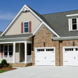 Suburban house exterior with two car garage...