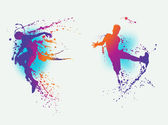 Man and woman dancing with colourfull splatter and splash