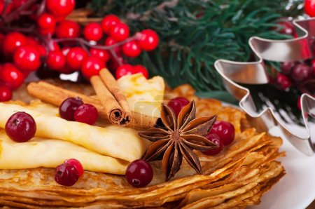 Photo for Pancakes with christmas berries and pastry forms of fir-tree and star - Royalty Free Image