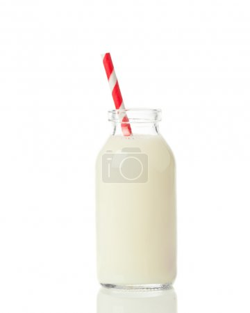 Fresh milk with drinking straw on a white backgrou...