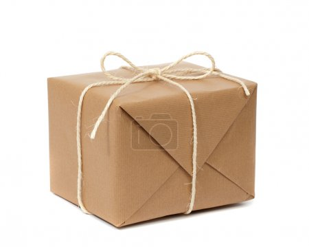 Photo for Cardboard carton wrapped with brown paper and tied with string - Royalty Free Image
