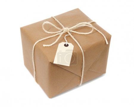 Photo for Parcel wrapped with brown paper, tied with string and with blank label - Royalty Free Image