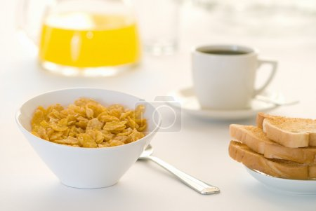 Photo for Breakfast table with cereal, toast, coffee and orange juice - Royalty Free Image