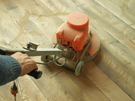 Photo for Sanding a hard wooden floor - Royalty Free Image