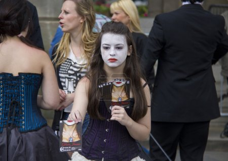 Girl handing out flyers at Edinburgh Festival