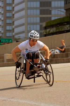 Female In Racing Wheelchair Works Out Along Chicago Asphalt