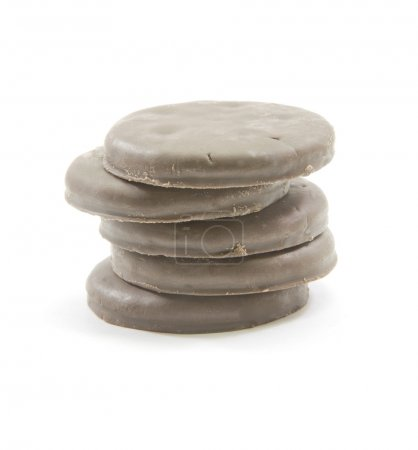 Photo for A stack of chocolate mint thin round cookies piled high. - Royalty Free Image
