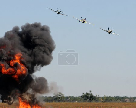 Photo for World War 2 ra fighter planes dropping bombs - Royalty Free Image
