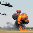 Helicopters mounting a ground attack with explosio...