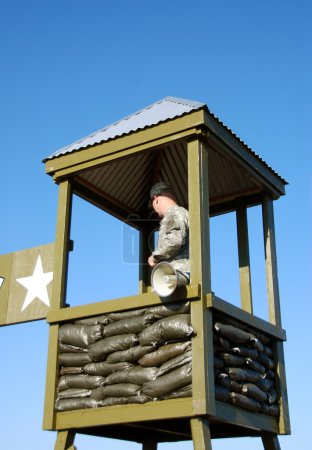 Soldier guarding military gate...