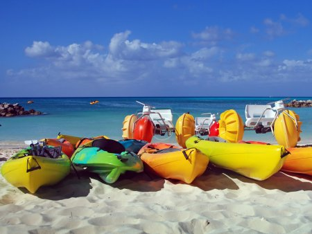 Photo for Colorful water sports equipment on a sandy beach - Royalty Free Image