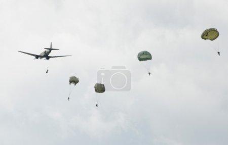 World War II era parachute drop on a cloudy day...