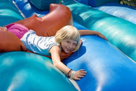 Girl playing on an inflatable toy